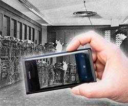 ENIAC computer viewed through smartphone