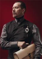Gary Oldman wearing Prada