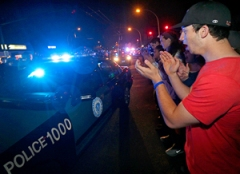 Police are applauded after Tsarnaev is captured